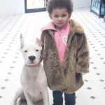 little girl hold her puppy