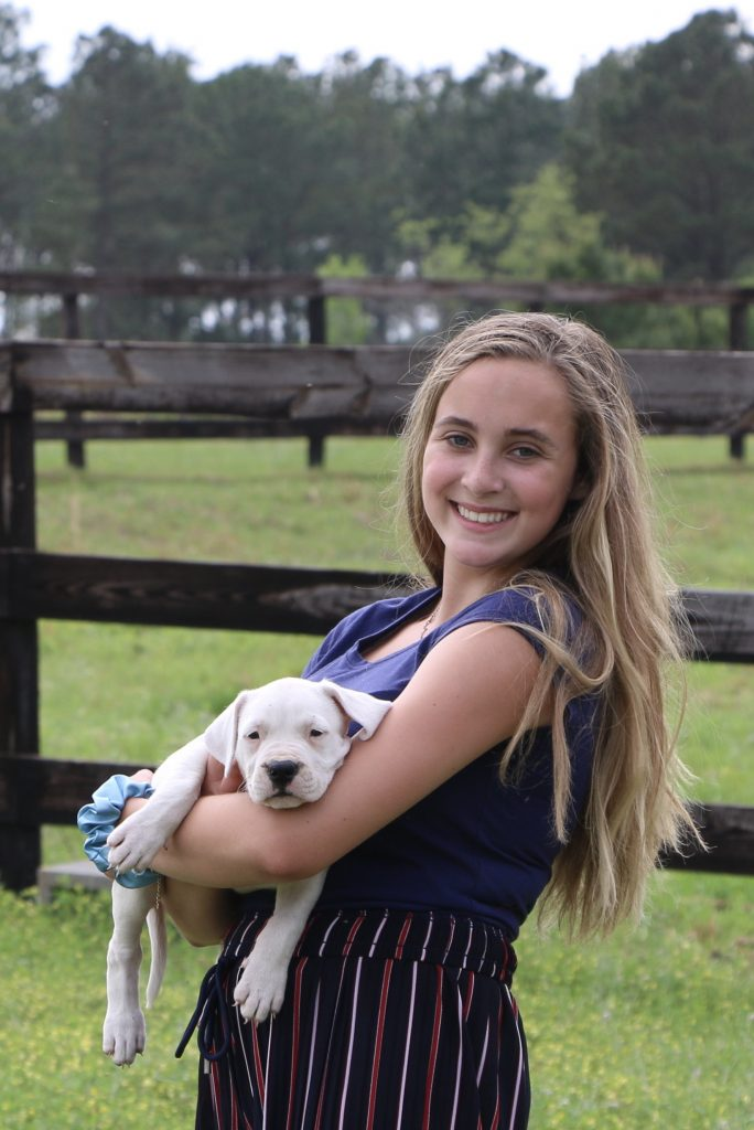 Girl holding her puppy