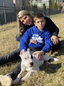 Mother and son with their puppy