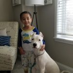 boy standing with his dog