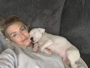 Woman laying with her puppy